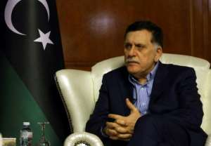 Libyan Prime Minister Fayez al-Sarraj speaks during an interview with AFP in Tripoli on November 8, 2018.  By Mahmud TURKIA (AFP)