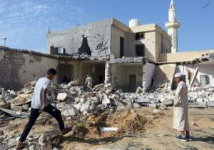 Libyans check the site of an air strike in which three children were killed and others wounded on the southern outskirts of Tripoli on October 14, 2019.  By Mahmud TURKIA (AFP/File)