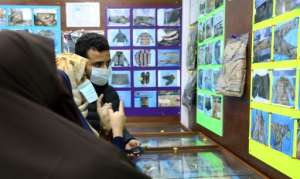 Libyans, shown in January, checking for news of loved ones check belongings of people found in mass graves around Tarhuna, at the forensic medicine department in Tripoli Medical Center.  By - (AFP/File)