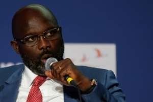 Liberia's new president, ex-football player George Weah, has lent the number from his national team jersey to a military hospital.  By FRANCOIS GUILLOT (AFP/File)