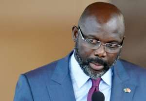 Liberia's President George Weah denies wanting to muzzle the media.  By SIA KAMBOU (AFP)