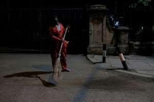 Lilian sweeps the streets of the capital.  By Kabir Dhanji (AFP)