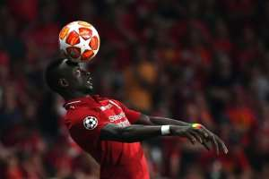 Liverpool star Sadio Mane demonstrates the aerial skills that Senegal hope will help them win the Africa Cup of Nations for the first time.  By GABRIEL BOUYS (AFP/File)
