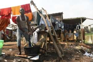 Living conditions for many remain dire, with half of Nigeria's 200 million people living in extreme poverty.  By PIUS UTOMI EKPEI (AFP)