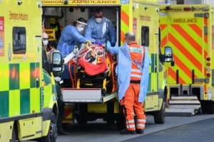 London ambulance staff stretcher a patient into the Royal London Hospital in the east of the city.  By DANIEL LEAL-OLIVAS (AFP)