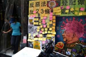 Long queues appeared outside Hong Kong businesses that support the city's pro-democracy movement as protesters used their spending power to help shops and restaurants.  By Anthony WALLACE (AFP)