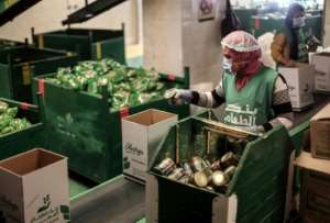 Long-life foodstuffs, including tinned products, feature prominently in the food boxes.  By Mohamed el-Shahed (AFP)