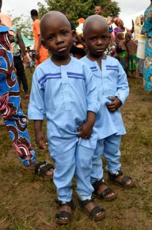 Local people say the high number of twins is due to their diet -- scientists are sceptical.  By PIUS UTOMI EKPEI (AFP)