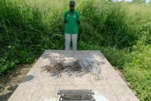 Louis Marie Mang, a UPC activist, stands before the tomb of anti-colonialist leader Ruben Um Nyobe.  By - (AFP)
