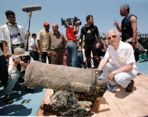 Louis-Napoleon Bonaparte-Wyse (R), a descendant of Napoleon, poses with a cannon retrieved from one of the general's sunken ships in Alexandria.  By AMR NABIL (AFP/File)