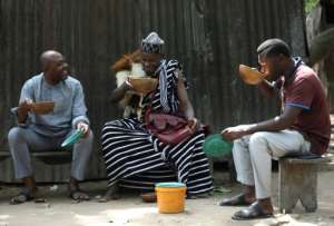 Many Nigerians prefer the taste -- and price -- of burukutu over industrially-made beer. But others are deterred by quality control and hygiene standards.  By Kola Sulaimon (AFP)