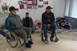 Many of those injured in the uprising are still awaiting recognition and compensation.  By FETHI BELAID (AFP)