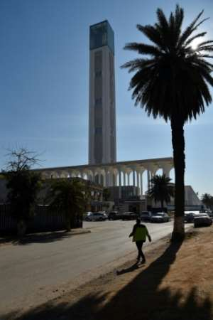 Many Algerians see the mosque as a symbol of megalomania and squandering of public funds..  By RYAD KRAMDI (AFP)