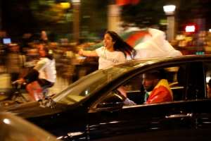 Many fans leaned precariously out of car windows as they waved red, white and green flags.  By Zakaria ABDELKAFI (AFP)