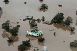 Many people in the Beira region fled for their lives or took to the rooftops as the floodwaters rose. By Rick Emenaket (Mission Aviation Fellowship/AFP)