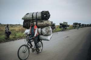 Many people in impoverished DR Congo rely on charcoal as their main fuel, which comes as a steep price for the environment.  By ALEXIS HUGUET (AFP)
