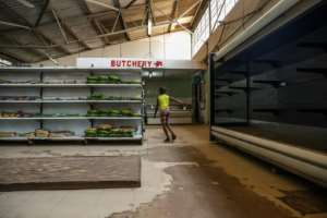 Many shops have been sporting empty shelves.  By Jekesai NJIKIZANA (AFP/File)