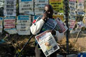 Man people in Harare were out working as normal Saturday, a day after the death of their former president.  By Jekesai NJIKIZANA (AFP)