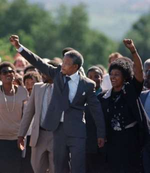 Mandela (C) and his then-wife Winnie raised their fists and saluted the cheering crowd.  By Alexander JOE (FILES/AFP/File)
