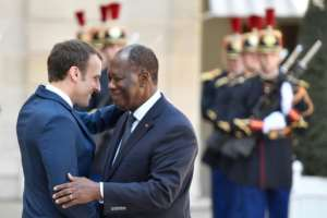 Macron (L) will also meet again with his Ivory Coast counterpart Alassane Ouattara.  By GERARD JULIEN (AFP)