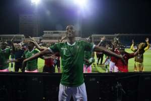 Madagascar celebrate their penalty shootout victory over DR Congo in the last 16.  By JAVIER SORIANO (AFP/File)