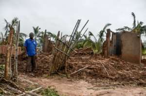 Madal said his family are sleeping under palm trees since his mud house was destroyed. By Emidio JOSINE (AFP)