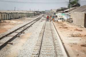 Maintenance staff walk along the renovated Accra-Tema line. Squatters had begun to encroach on the track during its closure. By RUTH MCDOWALL (AFP)