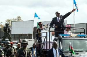 Malawi President Peter Mutharika waving to supporters following last May's election, annulled Monday.  By AMOS GUMULIRA (AFP/File)