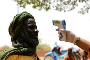 Mali has imposed a curfew and other controls to stop the spread of coronavirus as they vote goes ahead.  By Souleymane Ag Anara (AFP)