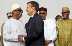 Mali President Ibrahim Boubacar Keita embraces France's Emmanuel Macron in July.  By Ludovic MARIN (POOL/AFP/File)