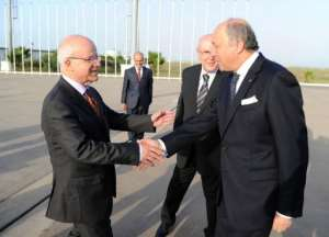 French Foreign Minister Laurent Fabius (R) is welcomed by Algerian Foreign Minister Mourad Medelci.  By Farouk Batiche (AFP)
