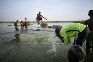 Malian children freshen up in the cool waters of the Niger River before breaking the fast.  By MICHELE CATTANI (AFP)
