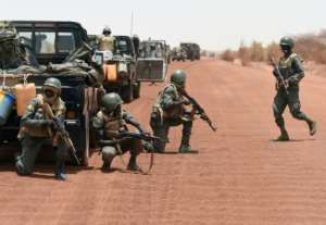 Malian soldiers are among those trying to counter the increasingly bold attacks of jihadists in the Sahel region.  By PHILIPPE DESMAZES (AFP)