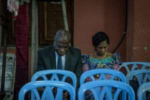 Martin Fayulu, seen praying with his wife Esther ahead of the results announcement, has rejected the declared outcome of the vote.  By Caroline Thirion (AFP)