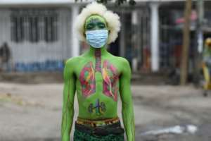 Masked: Performance artist Alex Kalemera tries to raise public awareness about the threat of coronavirus.  By Ericky BONIPHACE (AFP)