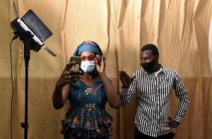 Masked rehearsals: Director Moustapha Kante and actress Aminata Diouf, who plays the role of Aby.  By Seyllou (AFP)