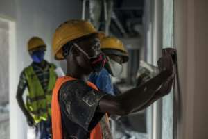 Masons and painters have been putting the finishing touches on the building, which is roughly the size of a hypermarket.  By Yanick Folly (AFP)