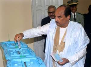 Mauritanian President Mohamed Ould Abdel Aziz casts his vote on September 1 at a polling station in Nouakchott, during the country's legislative, regional and local elections.  By AHMED OULD MOHAMED OULD ELHADJ (AFP)
