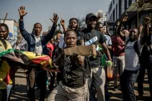 MDC supporters, who say their leader Nelson Chamisa won the vote, burnt tyres and pulled down street signs as protests spread from the party headquarters in Harare.  By Luis TATO (AFP)