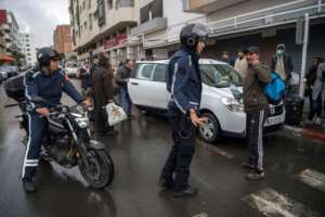 Members of Morocco's Interior Ministry Auxiliary Forces instruct a man to return home in the capital Rabat.  By FADEL SENNA (AFP)