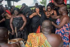 Members of Kofi Annan's extended family danced in his honour outside the Accra conference centre where his body was lying in state.  By CRISTINA ALDEHUELA (AFP)