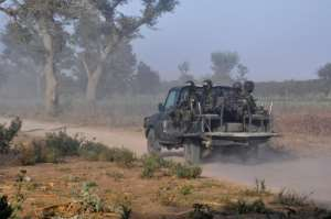 Members of the Cameroonian Rapid Intervention Force patrol on the outskirts of Mozogo. By Reinnier KAZE (AFP)