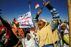 Men, women and children carrying pro-Bashir banners arrived in buses from early in the morning, almost filling the site.  By ASHRAF SHAZLY (AFP)