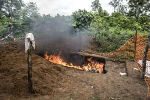 Measures against Ebola contagion include burning mattresses of the victims.  By John WESSELS (AFP/File)