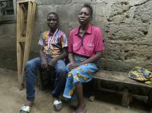 Mechanic Jamiu Ninilowo, 14, (L), joined the chess club in February and is now its best player.  By PIUS UTOMI EKPEI (AFP)