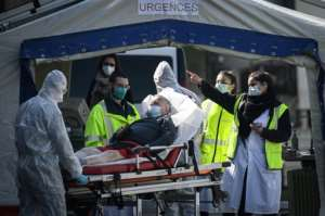 Medical personnel tended to patients at the reception of the Emergency Room, set up in a tent, in the suburbs of Paris.  By Philippe LOPEZ (AFP)
