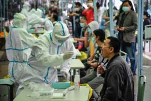Medical workers conduct mass COVID-19 tests in Wuhan in China's central Hubei province.  By STR (AFP)