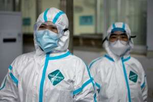 Medical workers wearing hazmat suits as prevention against the COVID-19 coronavirus at work at the Huanggang Zhongxin Hospital in Huanggang, in China's central Hubei province.  By NOEL CELIS (AFP)