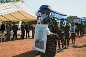 MINUSMA troops carry the coffins of four Ivorian comrades who were killed by a roadside bomb in northwestern Mali on January 13.  By ANNIE RISEMBERG (AFP)