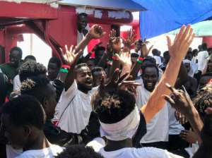 Migrants celebrate aboard the Ocean Viking rescue ship, operated by French NGOs SOS Mediterranee and Medecins sans Frontieres (MSF Doctors without Borders), after six EU countries agreed to take them in following 14 days at sea.  By Anne CHAON (AFP/File)